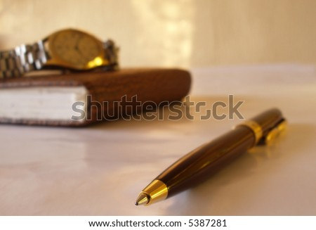 pen with notebook and clock - stock photo