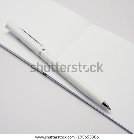 pen with white book - stock photo