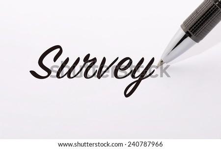 Pen write survey word on paper - stock photo