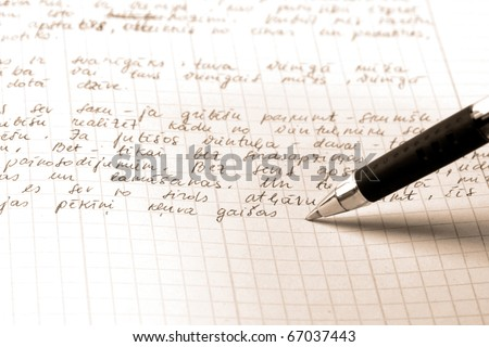 pen writes the text on a squared paper - stock photo