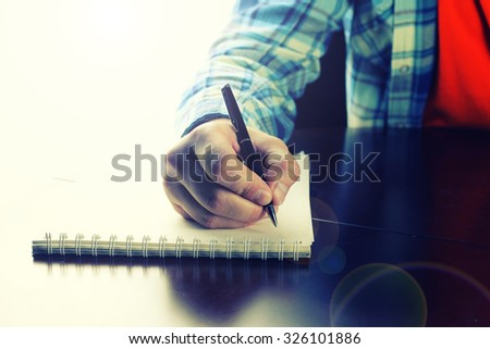 pen writing hand student