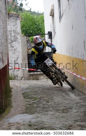 PENACOVA, PORTUGAL - MAY 27: Luis Ribeiro during the Taca de Portugal Downhill Urbano Vodafone on may 27, 2012 in Penacova, Portugal. - stock photo
