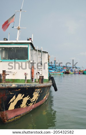 Penang harbour sea and old grunge boats