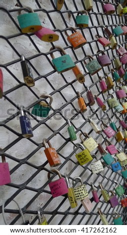 PENANG, MALAYSIA, AUGUST 29, 2015 : Love padlocks in Ipoh, Malaysia which symbolize their love will be locked forever. - stock photo