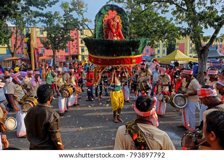 Penang, Malaysia - February 9th, 2017: Group of musician boosting spirit for the kavadi bearier on Thaipusam day.This sacrifice and offering performed by devotees to worship Lord Murugan