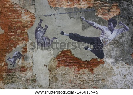 PENANG, MALAYSIA-JULY 6:General view of a mural 'The Real Bruce Lee Would Never Do This' painted by 101 Lost Kittens in Penang on JULY 6,2013.The mural is 1 of the 11 murals paintings in early 2012. - stock photo