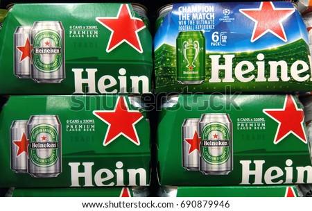 PENANG, MALAYSIA - JULY 19, 2017 : Heineken beer cans on store shelf. Heineken is a Dutch brewing company, founded in 1864 by Gerard Adriaan Heineken in Amsterdam.