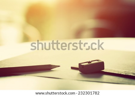 Penci, ruler and sharpenerl lying on blank piece of paper in morning light. Creative work, drawing etc. Vintage natural mood - stock photo