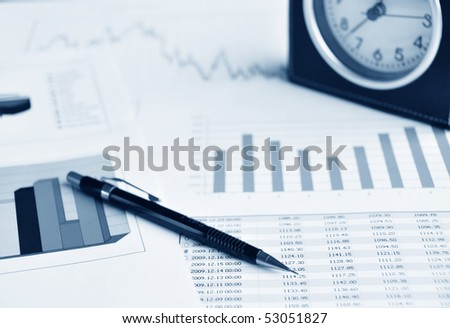 Pencil and a clock on a market report