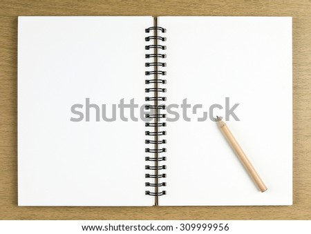 pencil and blank opened notebook , business , education