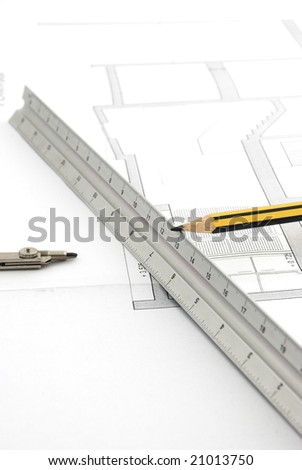 Pencil and compass on white background - stock photo