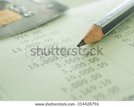 pencil and creditcard on passbook. selective focus. Accounts concept. - stock photo