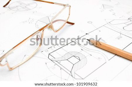 Pencil and glasses on the drawing. - stock photo