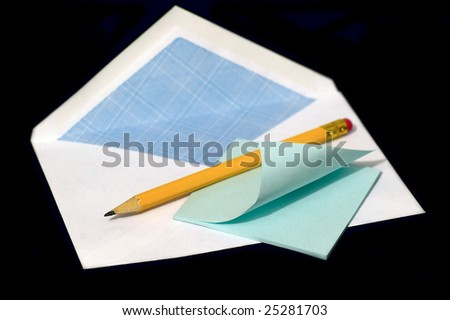 Pencil and note against the black background - stock photo