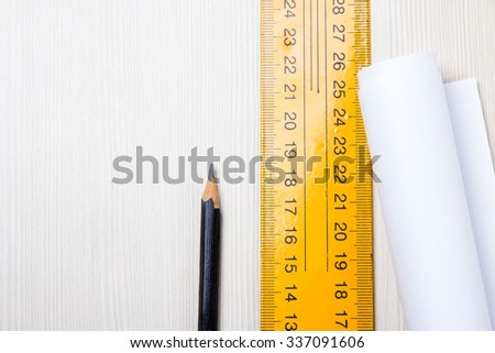 Pencil and ruler closeup on wooden Board. Copy-space. Top view