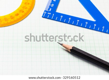 Pencil and Ruler on green graph paper with copy space , Selective focus - stock photo