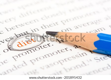 Pencil circle highlight on word diet on text book