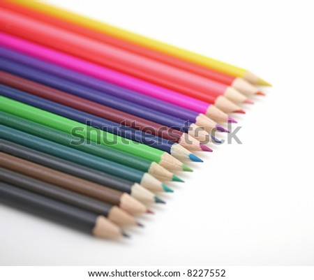 Pencil crayons over the white background