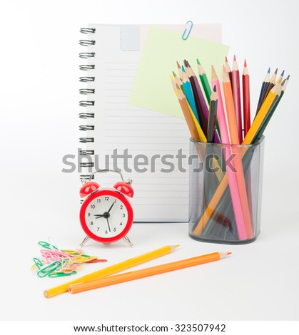 Pencil cup with crayons and pins on isolated white background