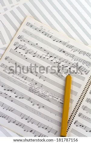Pencil drawn notes on music manuscript - stock photo