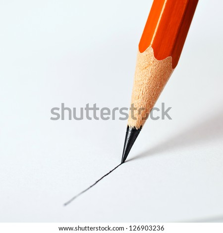 pencil draws a straight line on a white background - stock photo
