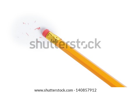 pencil erasing something, with pieces of rubber - stock photo