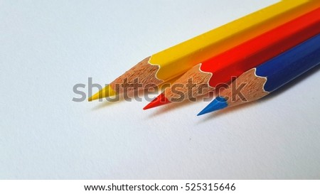 Pencil in the three primary colors blur lights