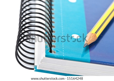 Pencil on a one notebook with soft shadow on white background. Shallow depth of field - stock photo