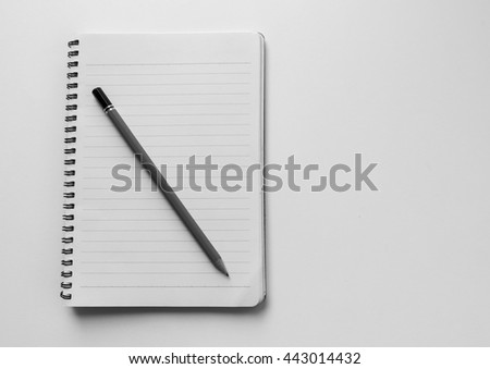 Pencil on empty white notebook