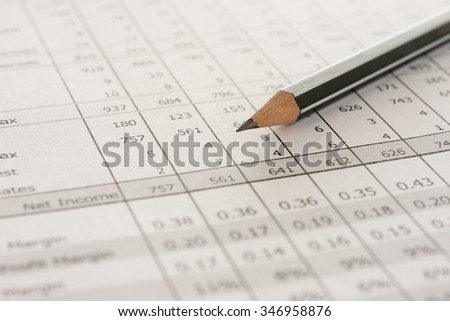 pencil on financial statement on accountant's desk. concept of acccounts. - stock photo