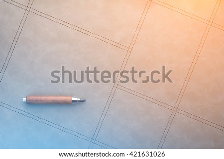 pencil on grey background with copy space and lighting concept - stock photo