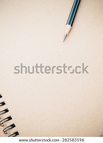Pencil on ring binding notebook with recycle brown paper for cover page,Selective focus on pencil sharpness, Film-like filter process - stock photo