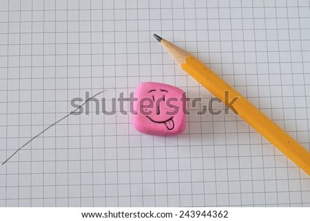 pencil, paper, eraser carved by hand smiley - stock photo