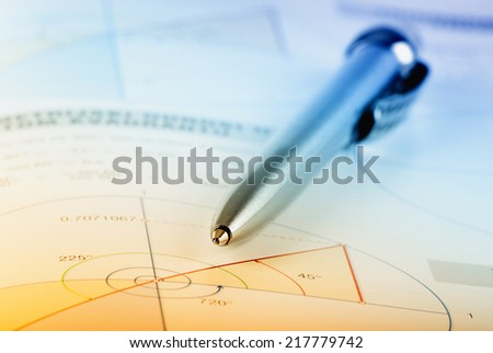 Pencil pointing on graph on white paper - stock photo