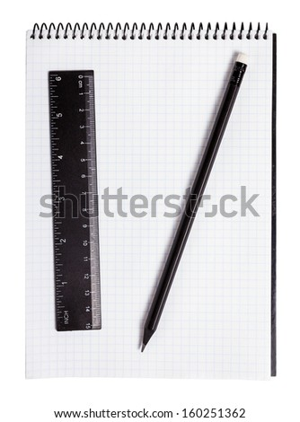 Pencil, ruler and notebook isolated on white