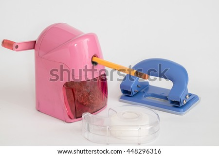 pencil sharpener and Scotch tape and Hole puncher isolated with white background - stock photo