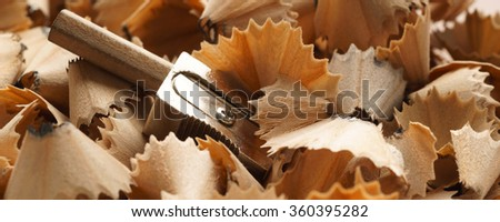 Pencil, sharpener and wood shavings on isolated on white background  - banner / header edition - stock photo