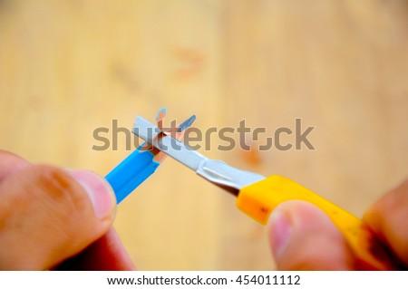 pencil sharpener on blur background - stock photo