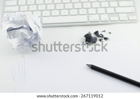pencil, white paper, and Computer Keyboard on Top of White Table - stock photo