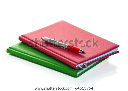 Pencil with a notebook. A close up - stock photo