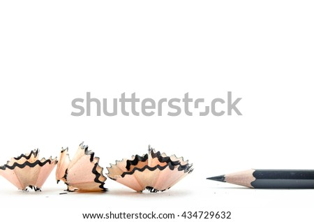 Pencil with sharpening shavings on white background. selective focus. - stock photo