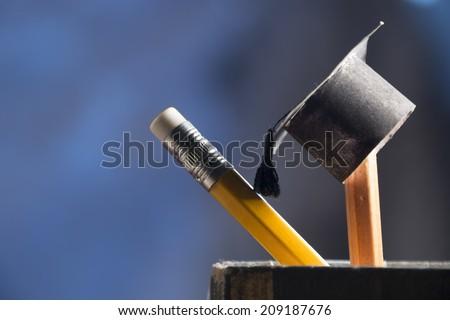 pencils and graduation hat, education concept - stock photo