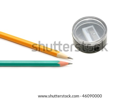 pencils and pencil sharpener on a white background - stock photo