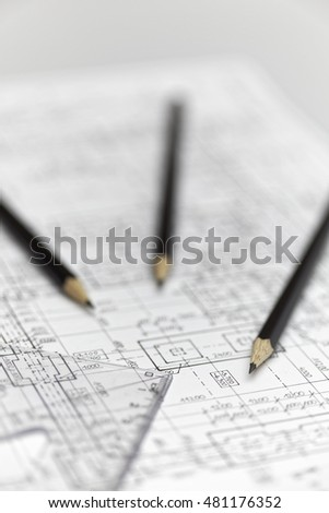 Pencils and ruler lay down on an architect plan.