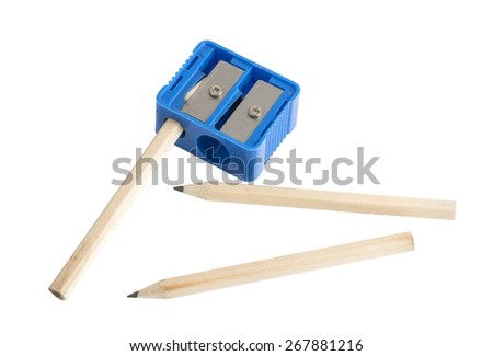 Pencils and sharpener isolated on a white background - stock photo