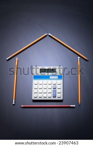 Pencils as house with calculator door. Desk as background. Copy space. Business and house finance concept. 10,000,000 on calculator. - stock photo