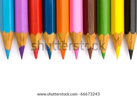 Pencils in a row on a white background.