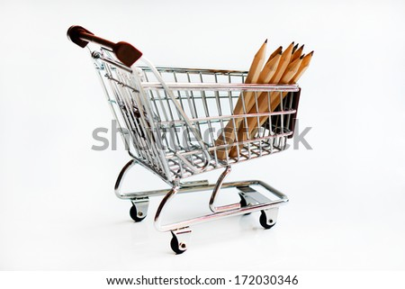 Pencils in shopping trolley isolated on white background - stock photo