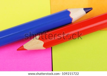 Pencils on color stickers background