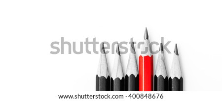 pencils on white, One red pencil standing out from the row of black pencils - stock photo